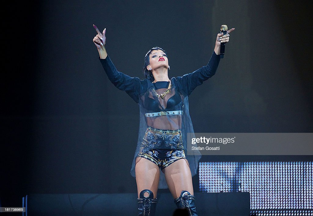 <a gi-track='captionPersonalityLinkClicked' href=/galleries/search?phrase=Rihanna&family=editorial&specificpeople=453439 ng-click='$event.stopPropagation()'>Rihanna</a> performs live for fans at the first show of her Australian Tour at Perth Arena on September 24, 2013 in Perth, Australia.