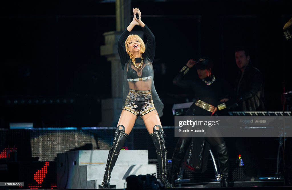 Rihanna performs live on stage at Twickenham Stadium on June 15, 2013 in London, England.