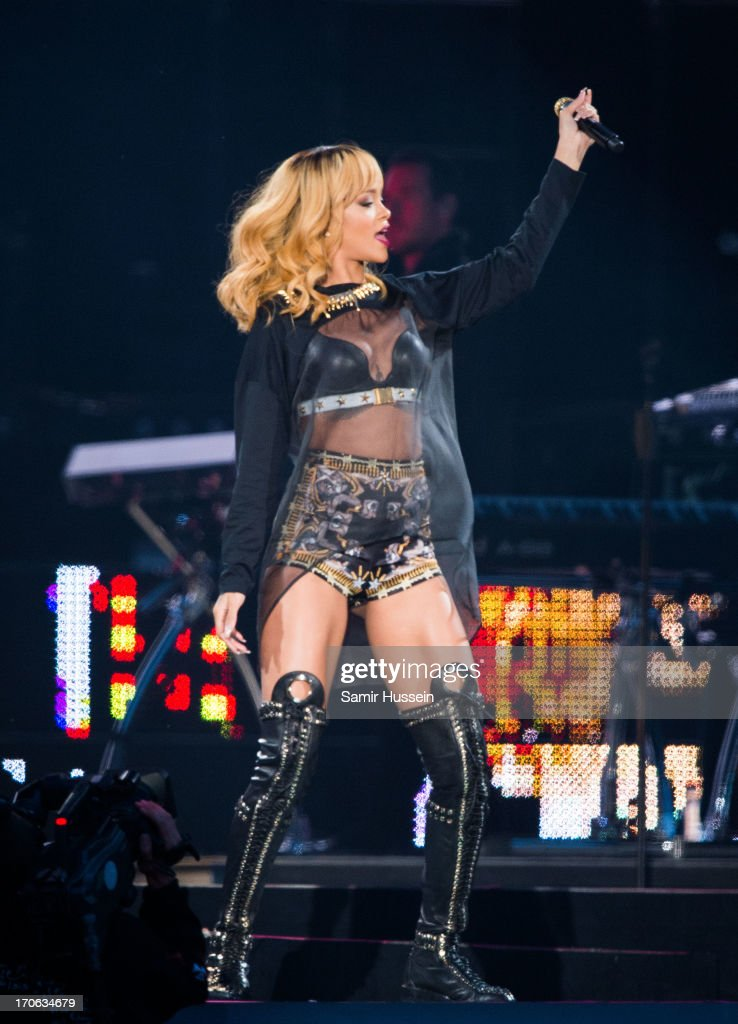 <a gi-track='captionPersonalityLinkClicked' href=/galleries/search?phrase=Rihanna&family=editorial&specificpeople=453439 ng-click='$event.stopPropagation()'>Rihanna</a> performs live on stage at Twickenham Stadium on June 15, 2013 in London, England.