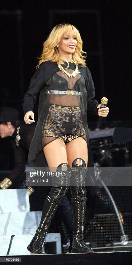 <a gi-track='captionPersonalityLinkClicked' href=/galleries/search?phrase=Rihanna&family=editorial&specificpeople=453439 ng-click='$event.stopPropagation()'>Rihanna</a> performs on stage at Twickenham Stadium on June 16, 2013 in London, England.