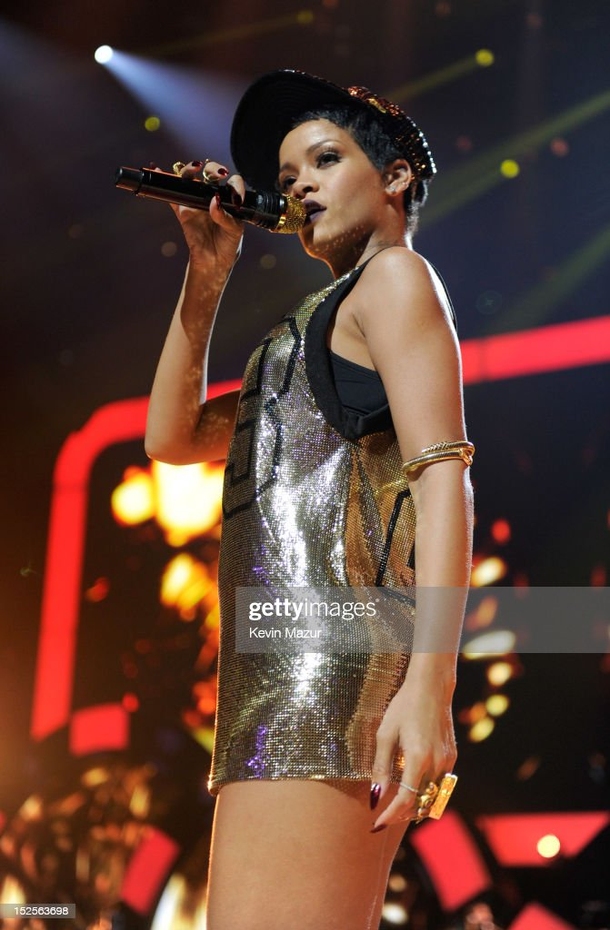 <a gi-track='captionPersonalityLinkClicked' href=/galleries/search?phrase=Rihanna&family=editorial&specificpeople=453439 ng-click='$event.stopPropagation()'>Rihanna</a> performs onstage during the 2012 iHeartRadio Music Festival at MGM Grand Garden Arena on September 21, 2012 in Las Vegas, Nevada.