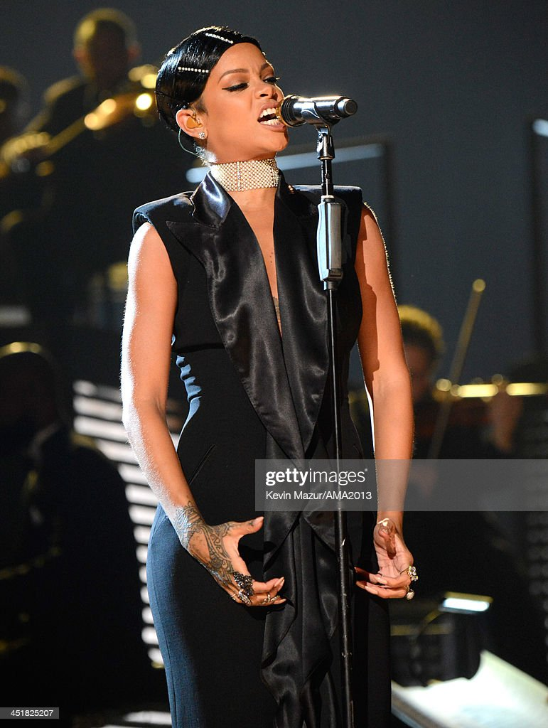 Rihanna performs onstage during the 2013 American Music Awards at Nokia Theatre L.A. Live on November 24, 2013 in Los Angeles, California.