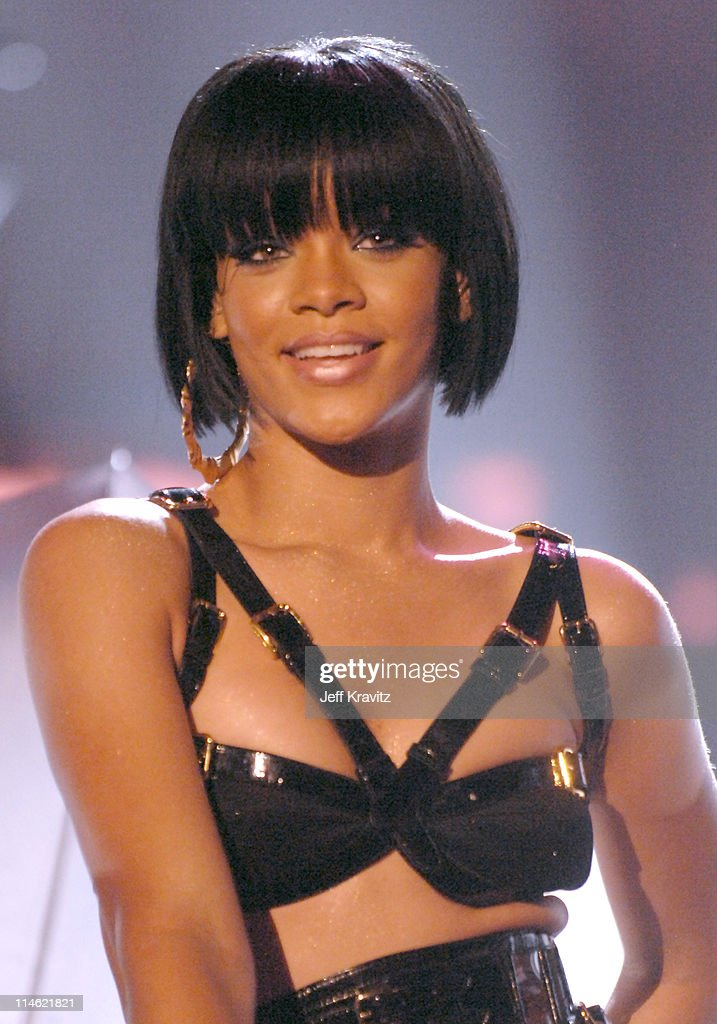 <a gi-track='captionPersonalityLinkClicked' href=/galleries/search?phrase=Rihanna&family=editorial&specificpeople=453439 ng-click='$event.stopPropagation()'>Rihanna</a> performs 'Umbrella' during 2007 MTV Movie Awards - Show at Gibson Amphitheater in Los Angeles, California, United States.