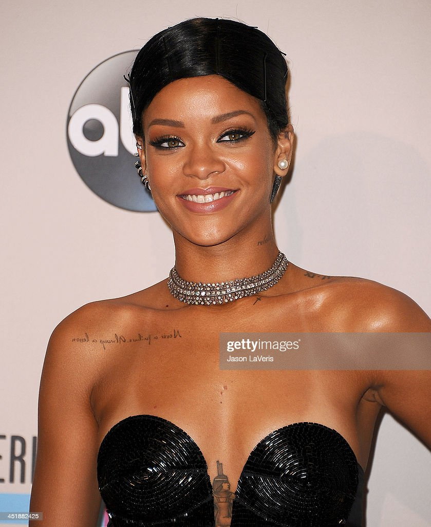 Rihanna poses in the press room at the 2013 American Music Awards at Nokia Theatre L.A. Live on November 24, 2013 in Los Angeles, California.