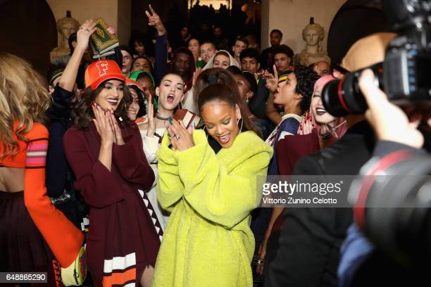 Rihanna poses with models backstage before FENTY PUMA by Rihanna Fall / Winter 2017 Collection at Bibliotheque Nationale de France on March 6 2017 in...