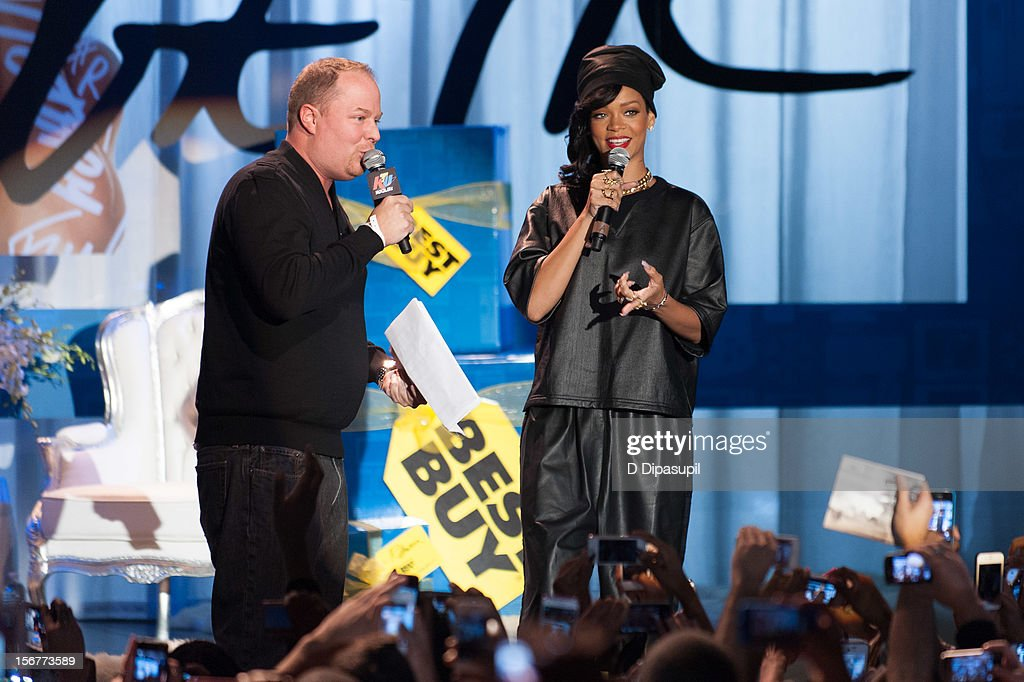 <a gi-track='captionPersonalityLinkClicked' href=/galleries/search?phrase=Rihanna&family=editorial&specificpeople=453439 ng-click='$event.stopPropagation()'>Rihanna</a> (R) promotes 'Unapologetic' at Best Buy Theater on November 20, 2012 in New York City.