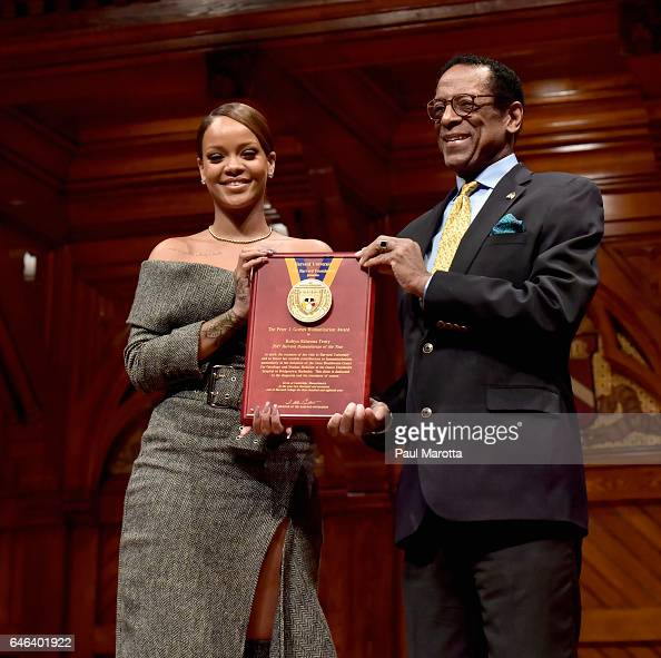 Rihanna receives the Harvard University Humanitarian of the Year Award from Dr S Allen Counter at Harvard University's Sanders Theatre on February 28...