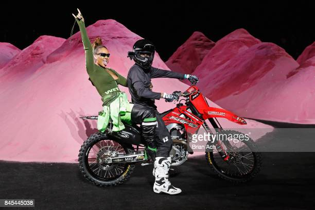 Rihanna rides a dirtbike on the runway at the FENTY PUMA by Rihanna Spring/Summer 2018 Collection at Park Avenue Armory on September 10 2017 in New...