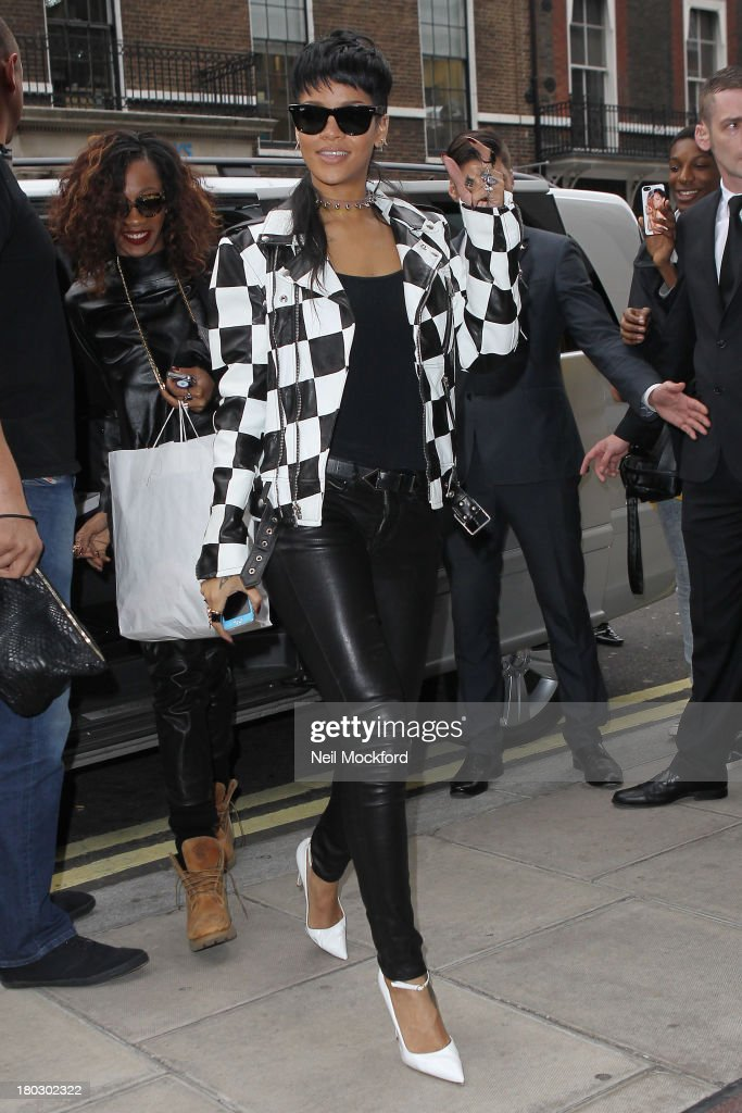 <a gi-track='captionPersonalityLinkClicked' href=/galleries/search?phrase=Rihanna&family=editorial&specificpeople=453439 ng-click='$event.stopPropagation()'>Rihanna</a> seen arriving at her hotel on September 11, 2013 in London, England.