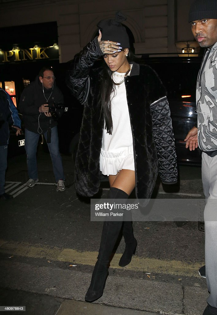 <a gi-track='captionPersonalityLinkClicked' href=/galleries/search?phrase=Rihanna&family=editorial&specificpeople=453439 ng-click='$event.stopPropagation()'>Rihanna</a> seen arriving at the private members club Tramp with Drake on March 27, 2014 in London, England.
