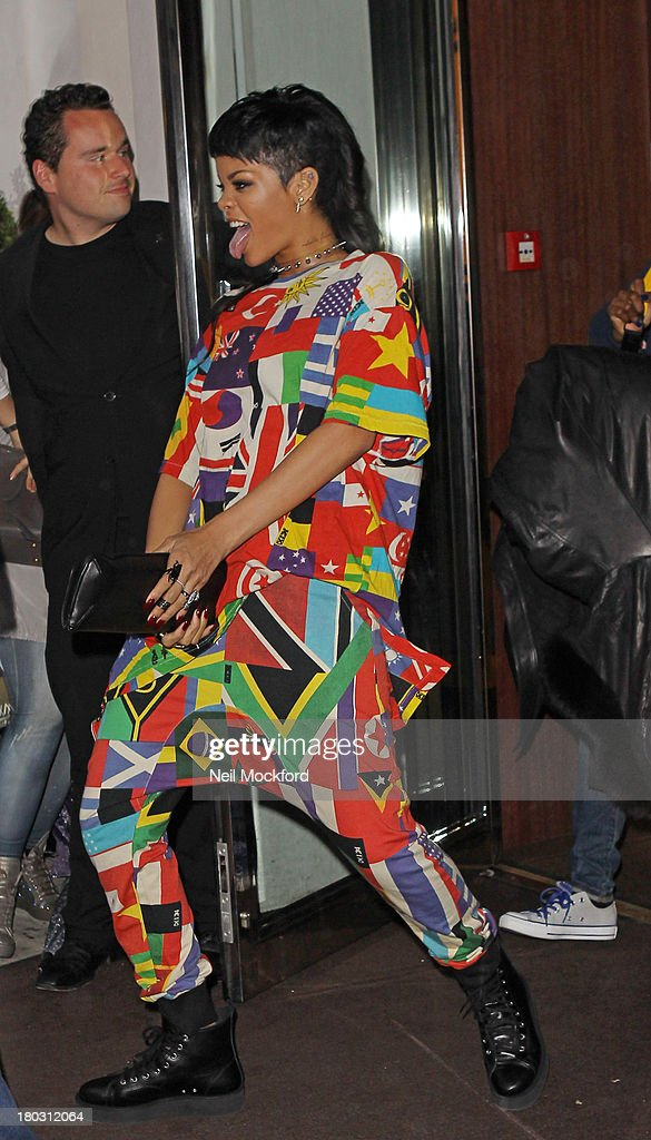 <a gi-track='captionPersonalityLinkClicked' href=/galleries/search?phrase=Rihanna&family=editorial&specificpeople=453439 ng-click='$event.stopPropagation()'>Rihanna</a> seen leaving her hotel on September 11, 2013 in London, England.