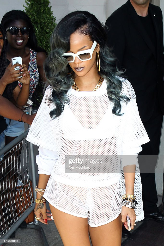 <a gi-track='captionPersonalityLinkClicked' href=/galleries/search?phrase=Rihanna&family=editorial&specificpeople=453439 ng-click='$event.stopPropagation()'>Rihanna</a> seen leaving her hotel to go to her Birmingham gig on July 18, 2013 in London, England.