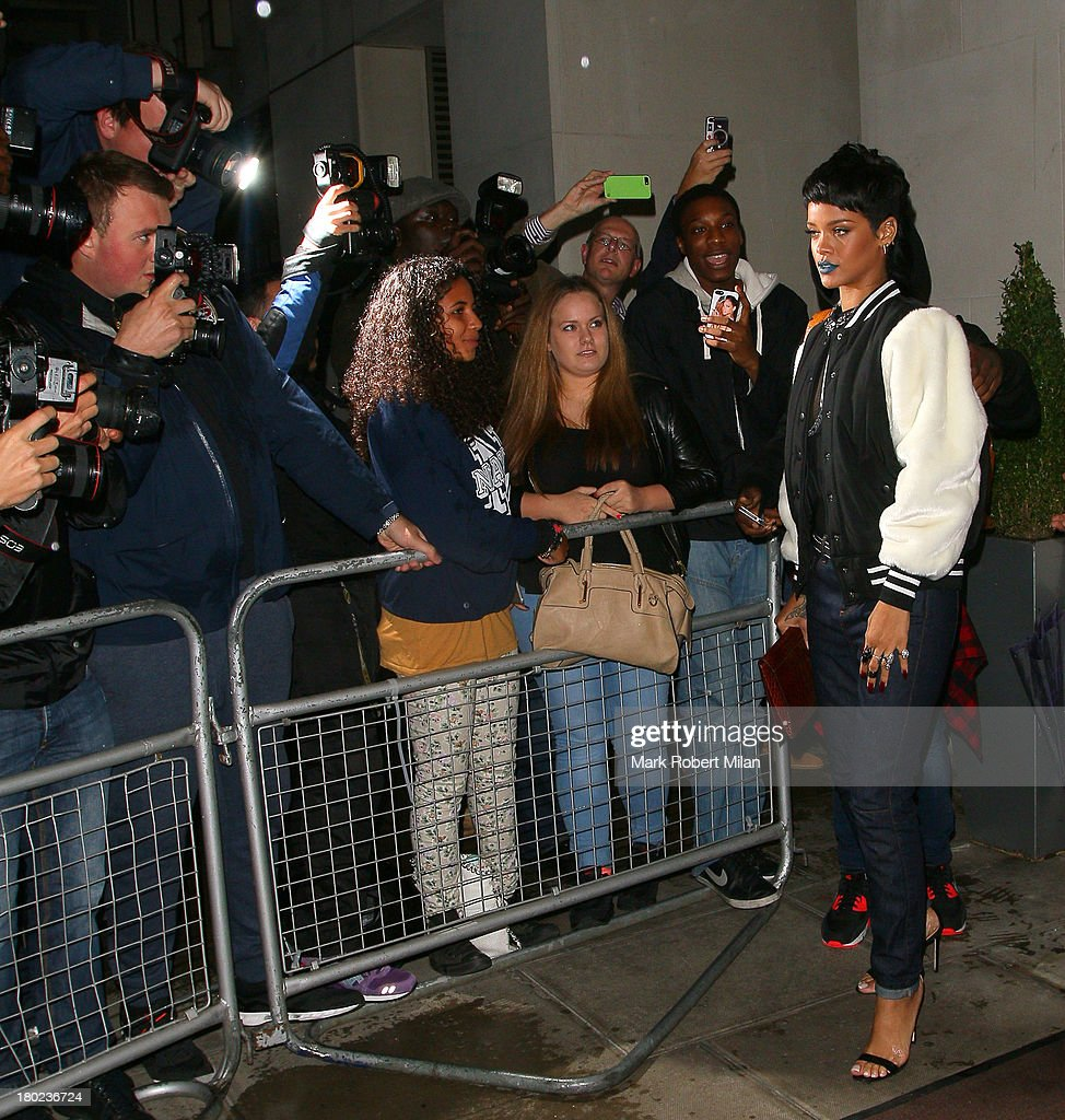 <a gi-track='captionPersonalityLinkClicked' href=/galleries/search?phrase=Rihanna&family=editorial&specificpeople=453439 ng-click='$event.stopPropagation()'>Rihanna</a> sighted leaving 45 Park Lane on September 10, 2013 in London, England.