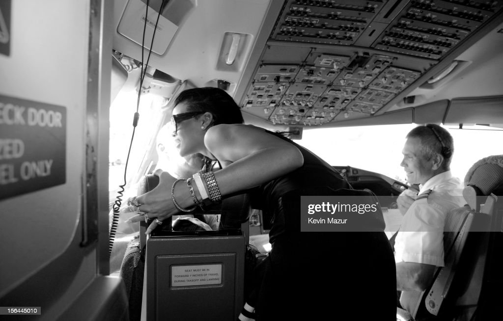 <a gi-track='captionPersonalityLinkClicked' href=/galleries/search?phrase=Rihanna&family=editorial&specificpeople=453439 ng-click='$event.stopPropagation()'>Rihanna</a> sits in the cockpit of the plane before taking off to her first stop on the 777 tour on November 14, 2012 in Los Angeles, California. <a gi-track='captionPersonalityLinkClicked' href=/galleries/search?phrase=Rihanna&family=editorial&specificpeople=453439 ng-click='$event.stopPropagation()'>Rihanna</a>'s 777 Tour - 7 countries, 7 days, 7 shows in celebration of the November 19, 2012 release of 'Unapologetic.'