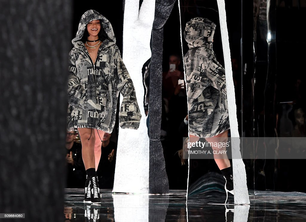 Rihanna takes a bow at the end of her show Fenty PUMA by Rihanna during the Fall 2016 New York Fashion Week in New York on February 12, 2016. / AFP / Timothy A. CLARY