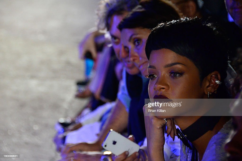 <a gi-track='captionPersonalityLinkClicked' href=/galleries/search?phrase=Rihanna&family=editorial&specificpeople=453439 ng-click='$event.stopPropagation()'>Rihanna</a> watches models walk the runway during the Opening Ceremony show during Spring 2014 Mercedes-Benz Fashion Week at SuperPier 25 on September 8, 2013 in New York City.