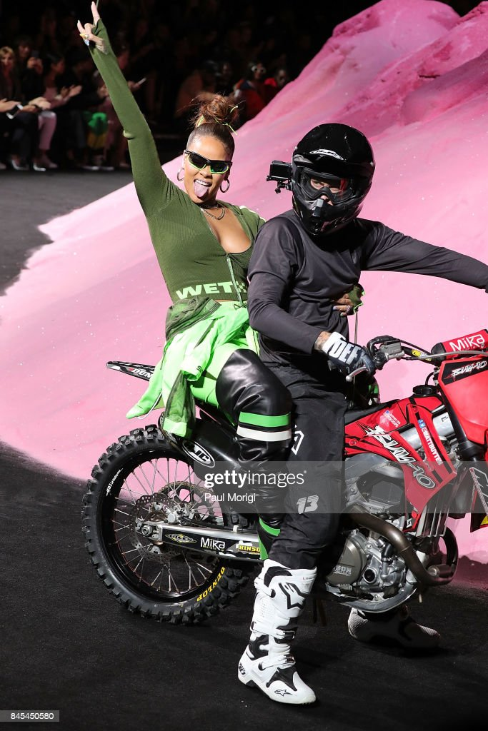 Rihanna waves from the back of a motorcycle at the finale of the Fenty Puma by Rihanna show during New York Fashion Week at the 69th Regiment Armory on September 10, 2017 in New York City.