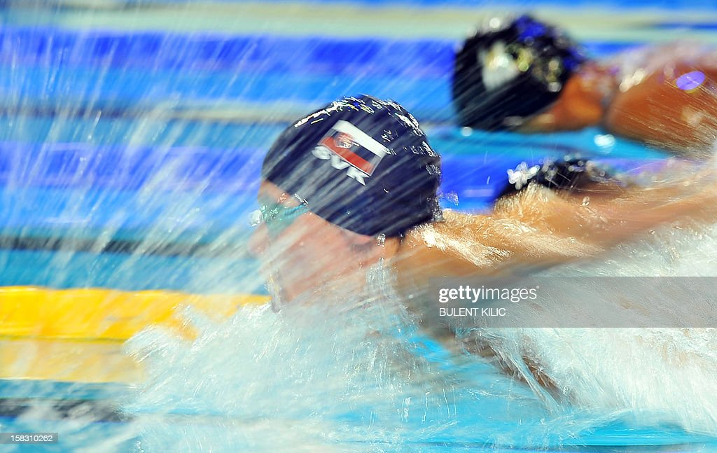 Rihard Nagy (L) of Slovakia competes during the men 400m individual medley qualification on December 13, 2012 of the FINA World Short Course Swimming Championships in Istanbul.