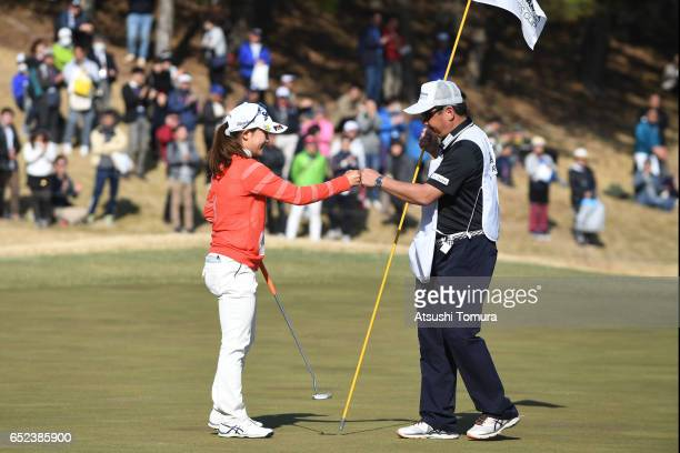 Riho Fujisaki of Japan celebrates after making her par putt on the 18th green during the final round of the Yokohama Tire PRGR Ladies Cup at the Tosa...