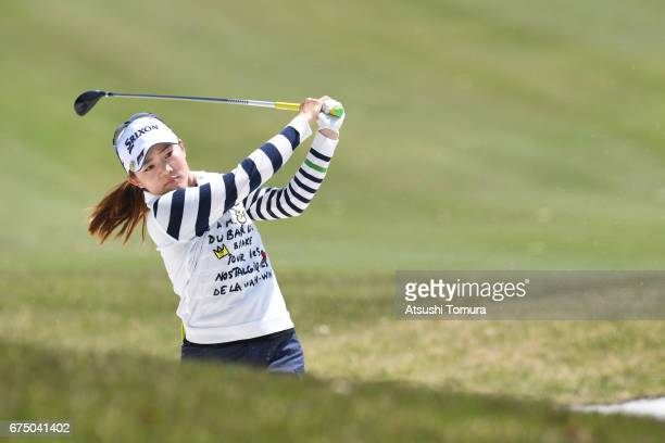 Riho Fujisaki of Japan hits from a bunker on the 5th hole during the final round of the CyberAgent Ladies Golf Tournament at the Grand Fields Country...