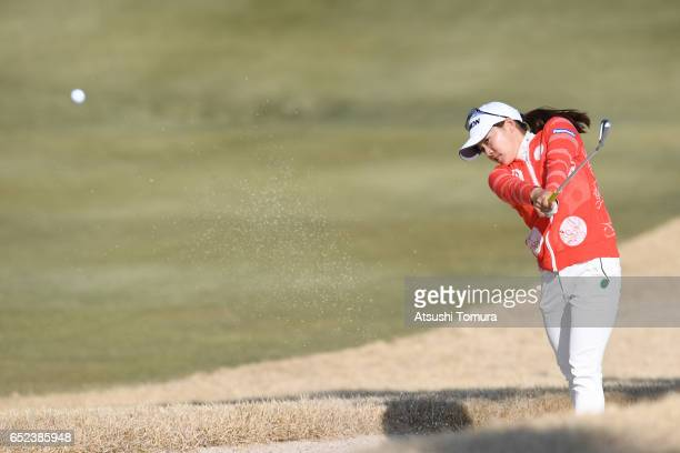Riho Fujisaki of Japan hits her second shot on the first playoff hole during the final round of the Yokohama Tire PRGR Ladies Cup at the Tosa Country...