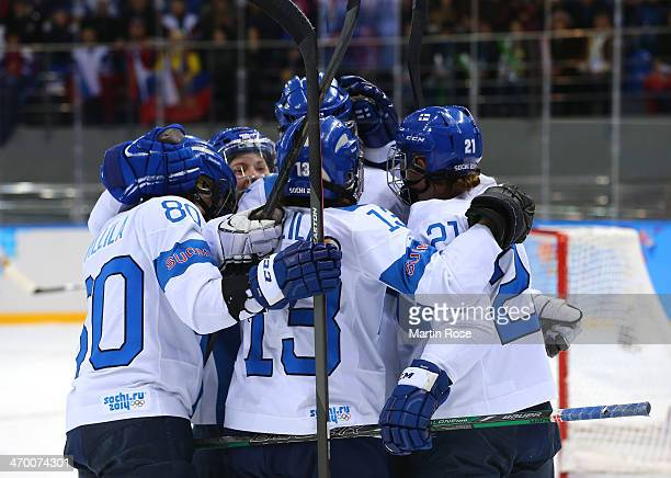 Riikka Valila of Finland celebrates with teammates after her goal in the first period against Russia during the Women's Classifications Game on day...
