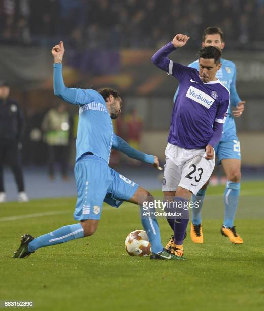 Rijeka's defender from Macedonia Leonard Zuta and Austria Wien's midfielder from Spain David De Paula vie for the ball during the UEFA Europa League...