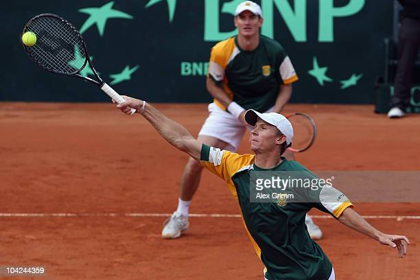Rik de Voest and Wesley Moodie of South Africa play against Christopher Kas and Andreas Beck of Germany during their double match at the Davis Cup...