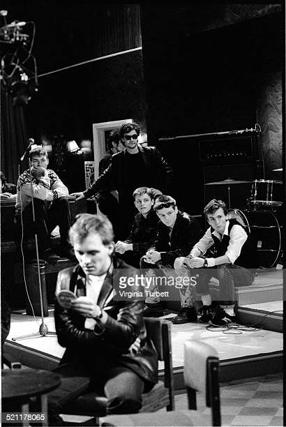 Rik Mayall as Rick with members of the band Madness behind on set during the filming of The Young Ones episode 'Boring' UK 19 August 1982