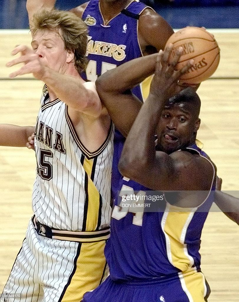 Rik Smits L of the Indiana Pacers battles Shaqui