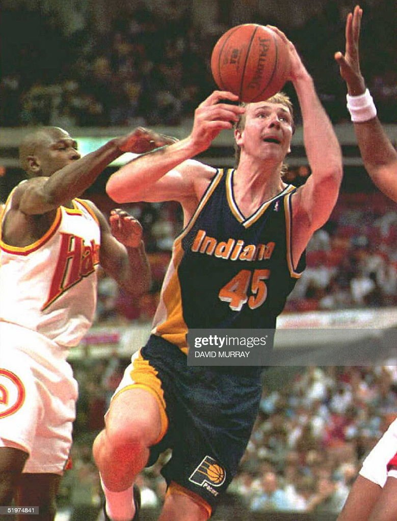 Rik Smits of the Indiana Pacers goes for a layup p