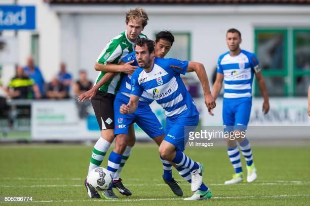 Rik van Dalfsen of SC Genemuiden Tijjani Reijnders of PEC Zwolle Dirk Marcellis of PEC Zwolleduring the friendly match between sc Genemuiden and PEC...