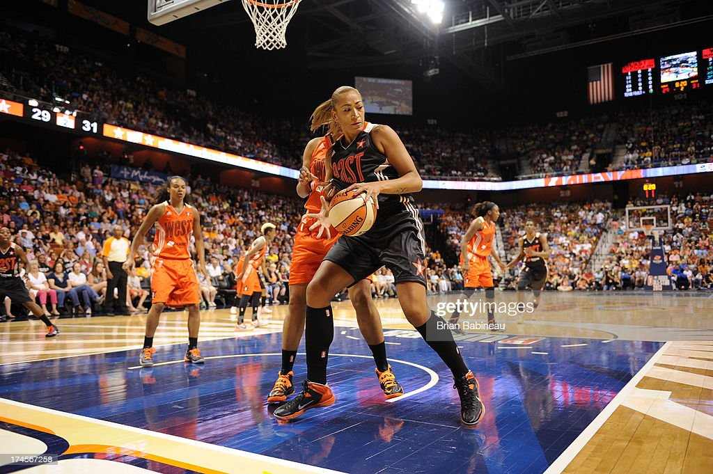 Érika de Souza #14 of the Eastern Conference All-Stars grabs a rebound against the Western Conference All-Stars during the 2013 Boost Mobile WNBA All-Star Game on July 27, 2013 at Mohegan Sun Arena in Uncasville, Connecticut.
