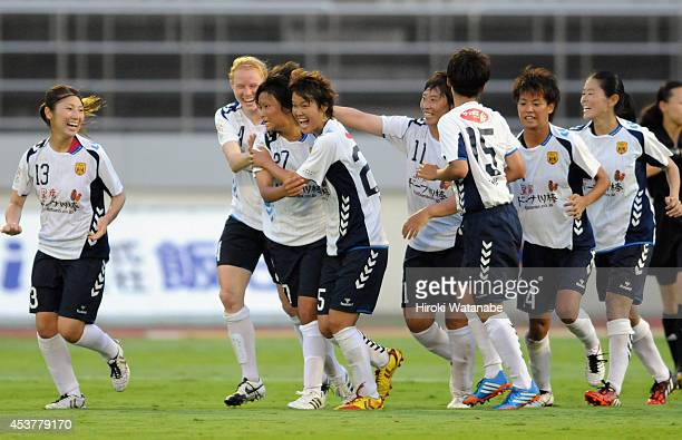 Rika Masuya of INAC celebrates scoring her team's first goal with her teammates during the Nadeshiko League match between Urawa Red Diamonds Ladies...