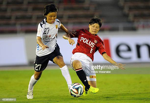 Rika Masuya of INAC is tackled by Hikaru Naomoto of Urawa Reds Ladies during the Nadeshiko League match between Urawa Red Diamonds Ladies and INAC...