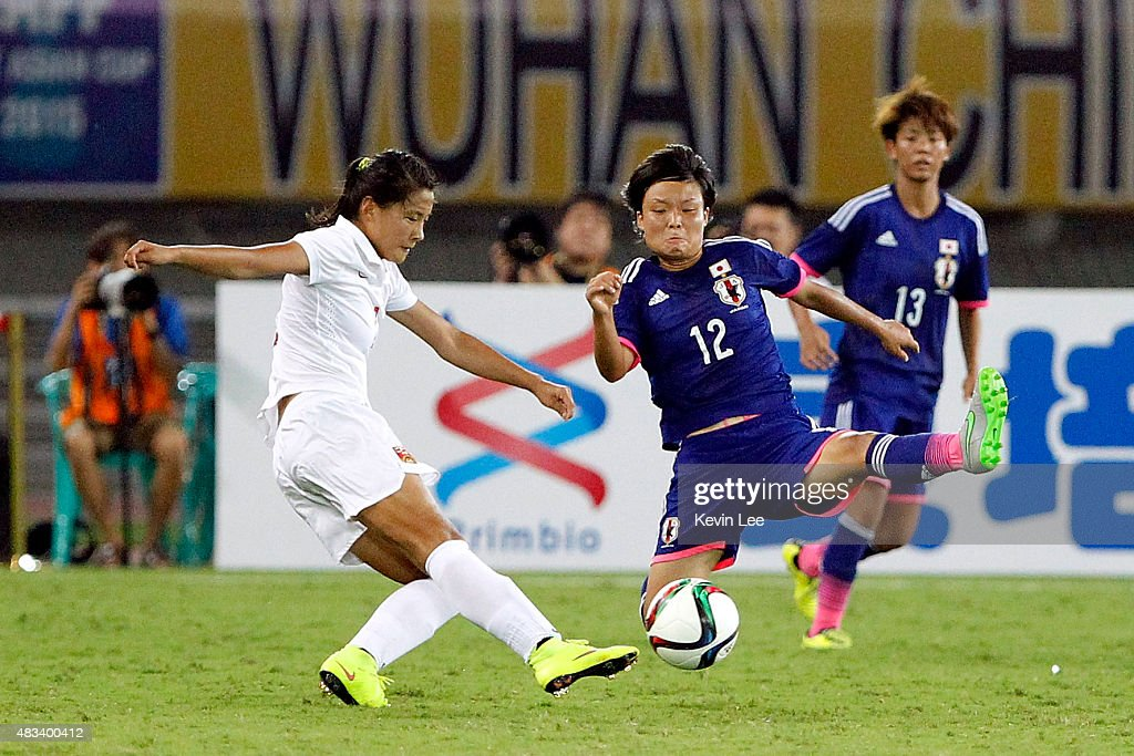 Rika Masuya of Japan challenges Wang Fei of China PR during the EAFF East Asian Cup 2015 final round at the Wuhan Sports Center Stadium on August 8...