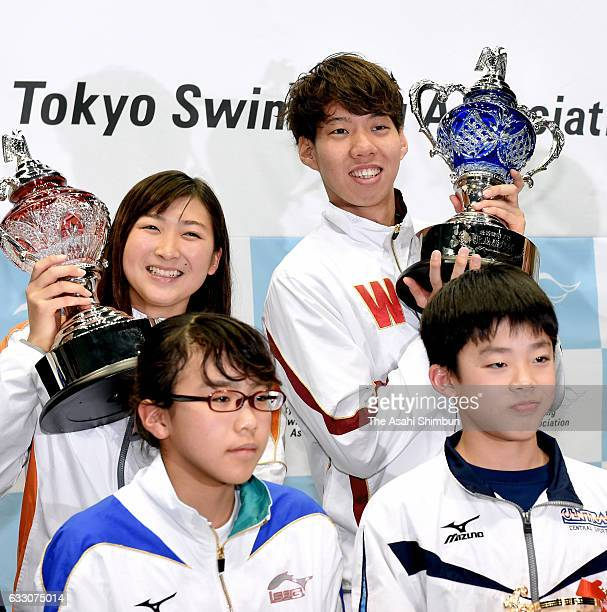 Rikako Ikee and Ippei Watanabe pose for photographs at the award ceremony during day two of the Kosuke Kitajima Cup Tokyo Swimming Championships at...