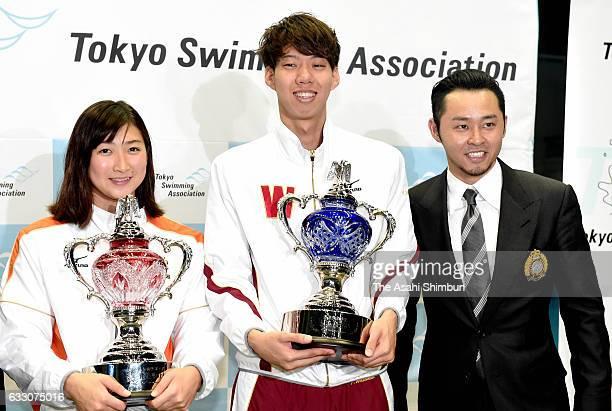 Rikako Ikee Ippei Watanabe and Kosuke Kitajima pose for photographs at the award ceremony during day two of the Kosuke Kitajima Cup Tokyo Swimming...