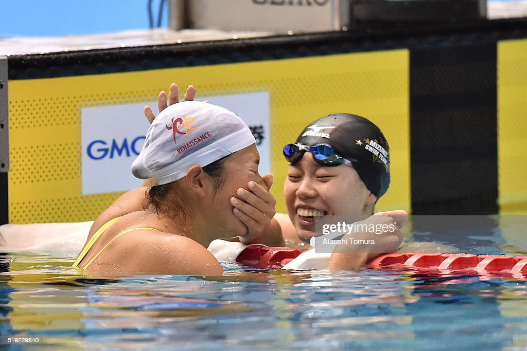 Rikako Ikee of Japan (L) and Natsumi Hoshi of Japan (R) celebrate after the Women's 100m Butterfly final during the Japan Swim 2016 at Tokyo Tatsumi International Swimming Pool on April 5, 2016 in Tokyo, Japan.