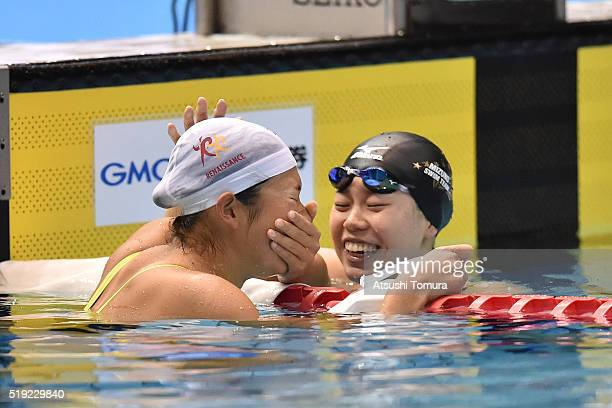 Rikako Ikee of Japan and Natsumi Hoshi of Japan celebrate after the Women's 100m Butterfly final during the Japan Swim 2016 at Tokyo Tatsumi...