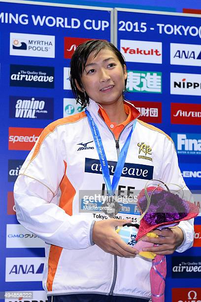 Rikako Ikee of Japan pose on the podium after the Women's 100m Freestyle final during the FINA Swimming World Cup 2015 at Tokyo Tatsumi International...