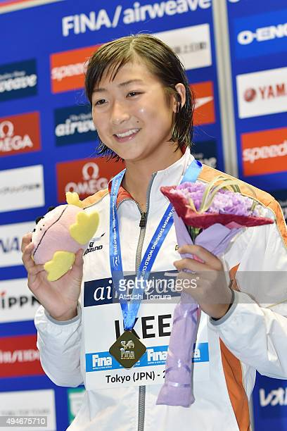Rikako Ikee of Japan poses on the podium after winning the Women's 100m Butterfly final during the FINA Swimming World Cup 2015 at Tokyo Tatsumi...