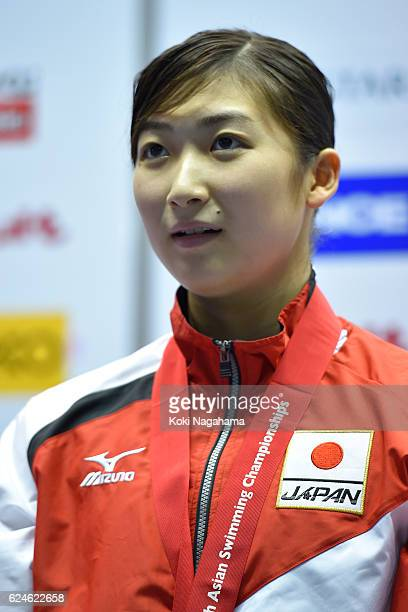 Rikako Ikee of Japan stands for her national anthem on the podium after 4x100m Medley Relay final during the 10th Asian Swimming Championships 2016...