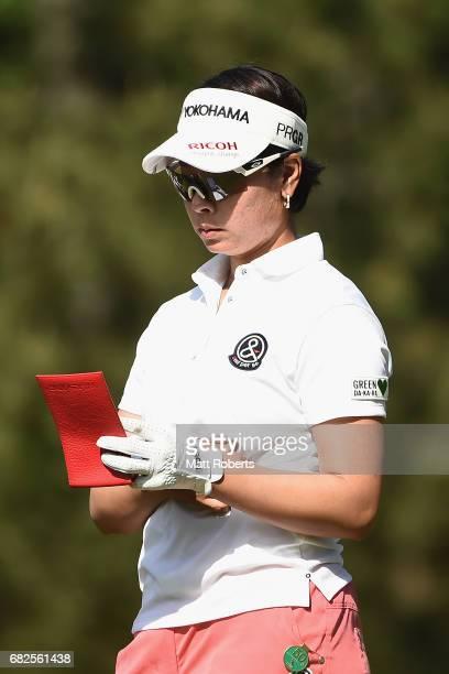 Rikako Morita of Japan looks at her yardage book during the second round of the HokennoMadoguchi Ladies at the Fukuoka Country Club Wajiro Course on...