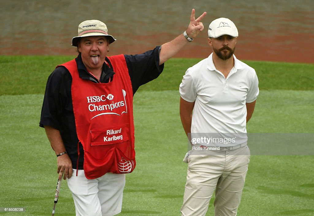 Rikard Karlberg of Sweden and his caddie Michael Donaghy on the 18th green during the first round of the WGC - HSBC Champions at the Sheshan International Golf Club on October 27, 2016 in Shanghai, China.