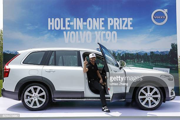 Rikard Karlberg of Sweden celebrates wins a hole in one prize at the 16th hole during the Volvo China open April 28 2016 in Beijing China