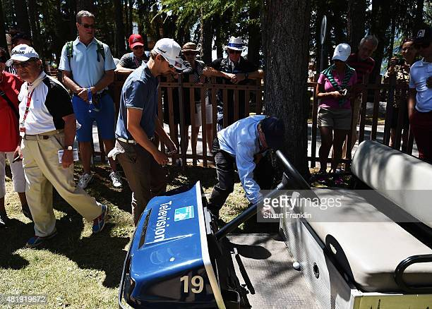 Rikard Karlberg of Sweden finds his ball has landed on on golf cart on the sixth hole during the third round of the Omega European Masters at...