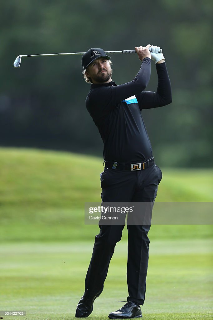<a gi-track='captionPersonalityLinkClicked' href=/galleries/search?phrase=Rikard+Karlberg&family=editorial&specificpeople=4648136 ng-click='$event.stopPropagation()'>Rikard Karlberg</a> of Sweden hits his 2nd shot on the 9th hole during day one of the BMW PGA Championship at Wentworth on May 26, 2016 in Virginia Water, England.