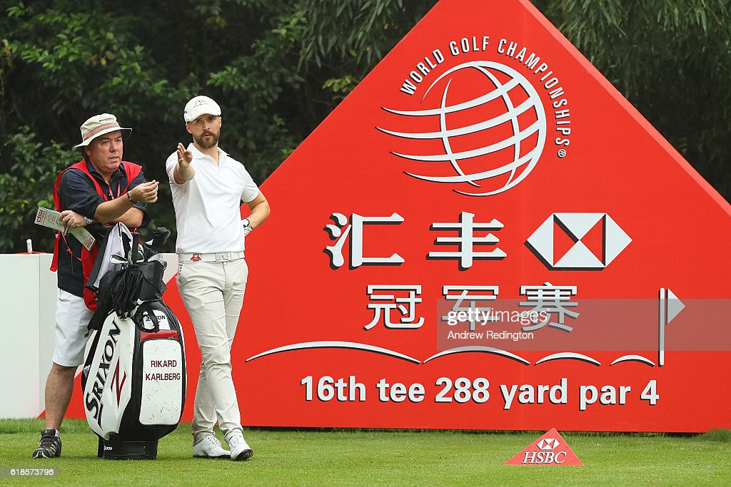 Rikard Karlberg of Sweden looks down the 16th hole with caddie Mick Donaghy during day one of the WGC - HSBC Champions at Sheshan International Golf Club on October 27, 2016 in Shanghai, China.