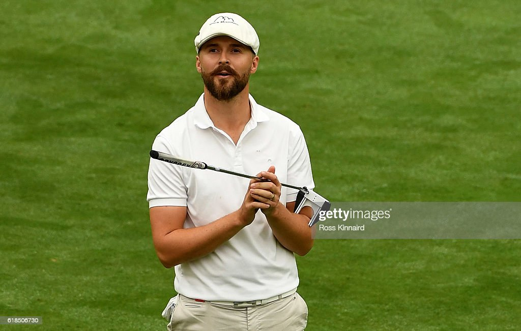 Rikard Karlberg of Sweden reacts after his putt on the 18th green during the first round of the WGC - HSBC Champions at the Sheshan International Golf Club on October 27, 2016 in Shanghai, China.